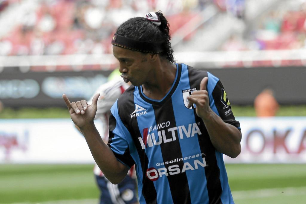 Queretaro's Ronaldinho celebrates